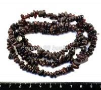 Натуральный камень ГРАНАТ крошка Округлая 4*2 - 10*5 мм, 82 см/нить 052501 - 99 бусин