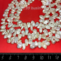 Натуральный жемчуг барочный, мятый неправильной формы, размер от 9,5*6 до 11*8,5 мм, цвет белый с серым оттенком, с перламутровыми переливами, около 37 см/нить 062673 - 99 бусин